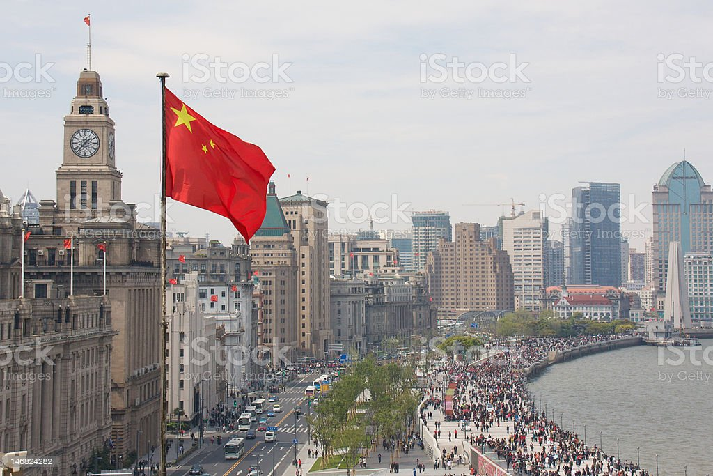 The Bund in Shanghai, China, with Chinese flag royalty-free stock photo