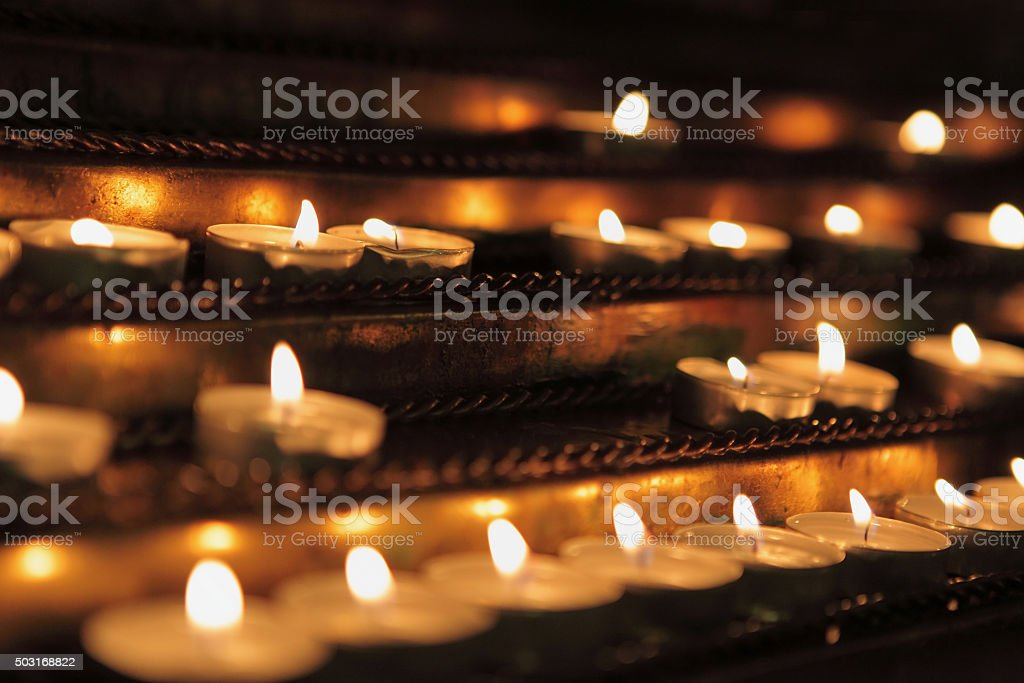 The burning candles in church close up stock photo