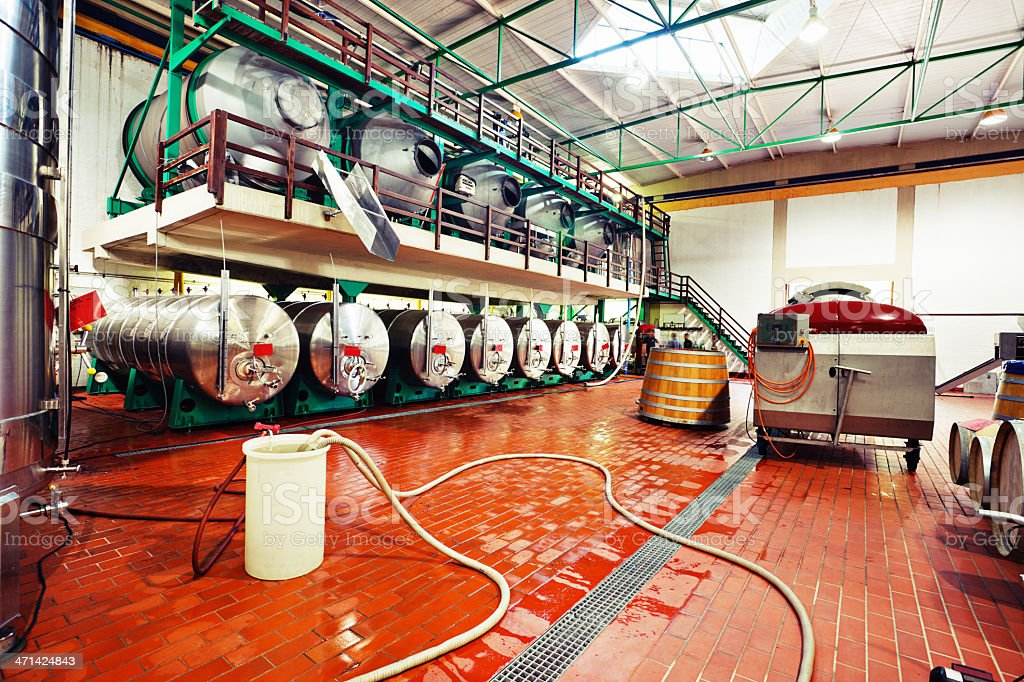 The business end of winemaking: stainless steel equipment at winery royalty-free stock photo