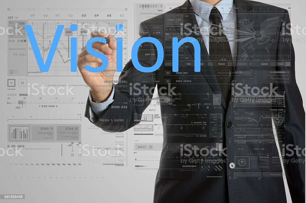 the businessman is writing Vision on the transparent board stock photo