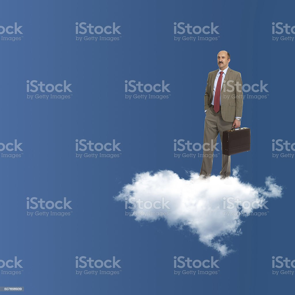 The businessman stands on a cloud stock photo