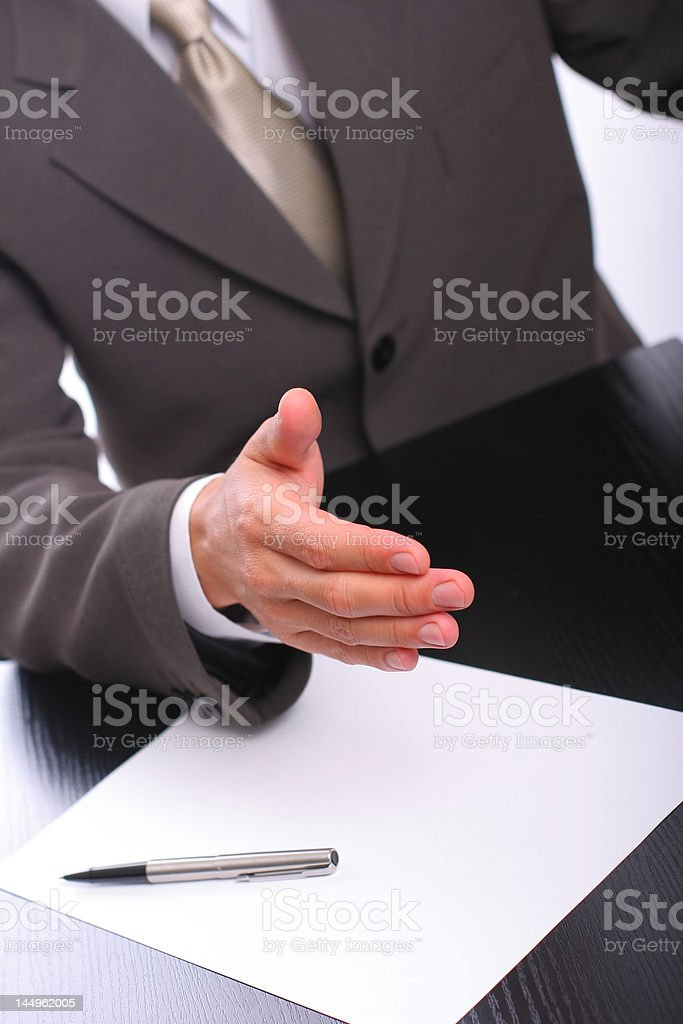 The businessman stretches a hand for handshake royalty-free stock photo