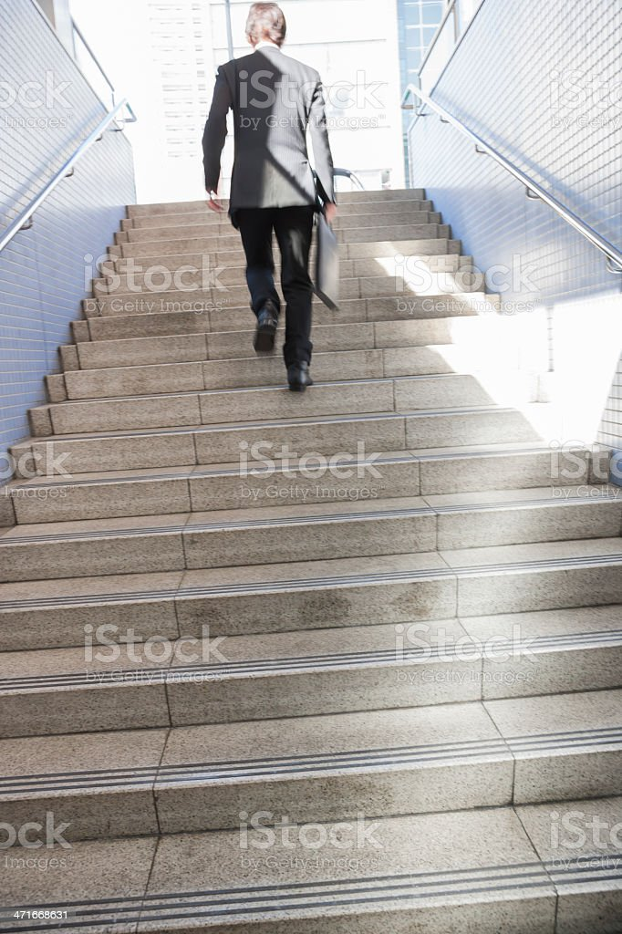The businessman who walks royalty-free stock photo
