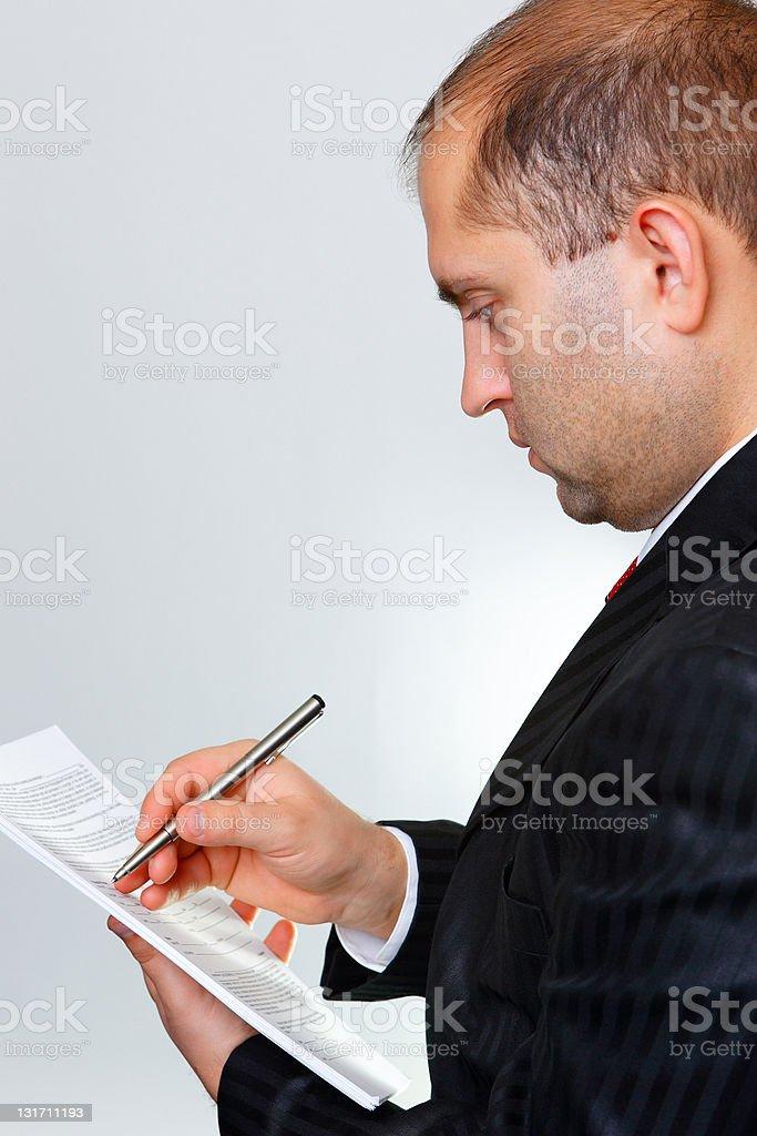 The businessman writes royalty-free stock photo