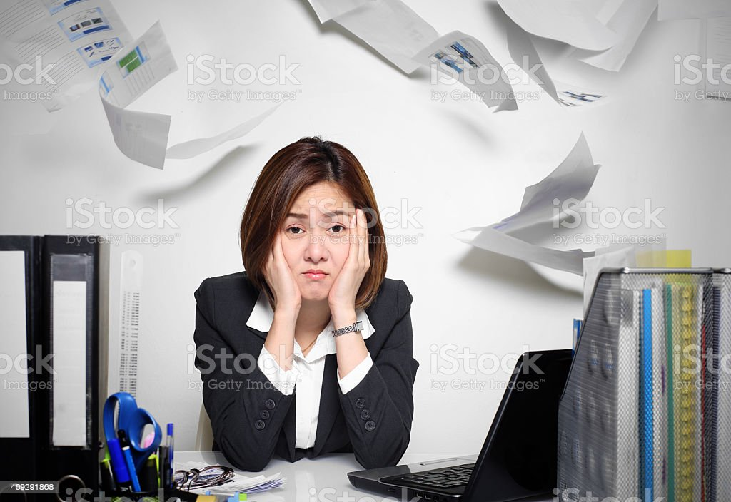 The businesswoman asian serious and busy with trouble her working stock photo
