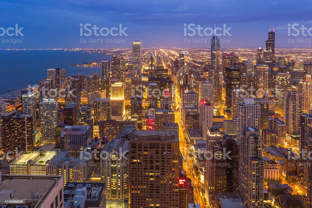 The bustling Chicago downtown skyline at night in Illinois stock photo