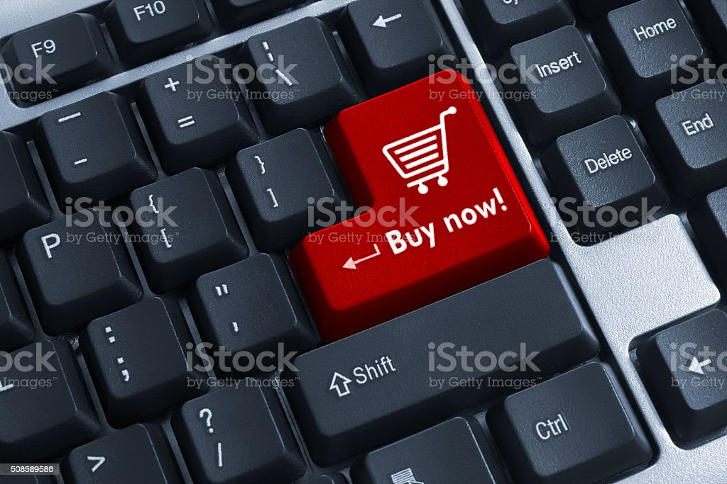 The Buy now red button on keyboard stock photo
