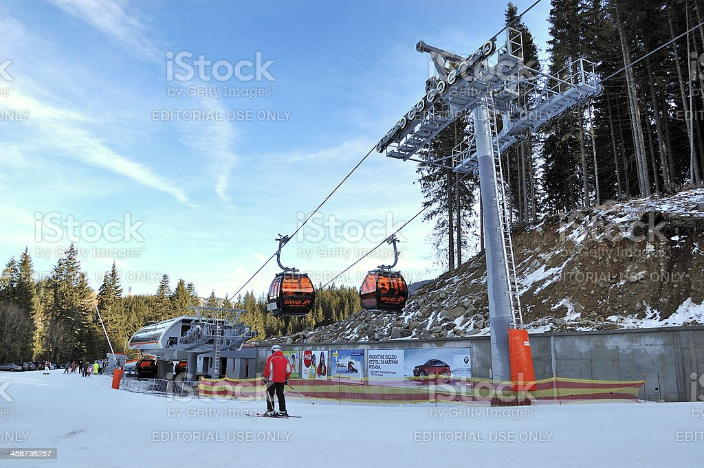The cableway and skier in Jasna Low Tatras ski resort stock photo
