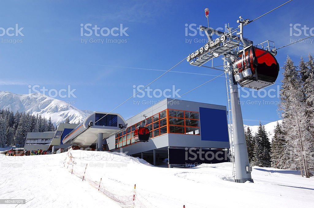 The cableway station at popular ski resort and slope stock photo