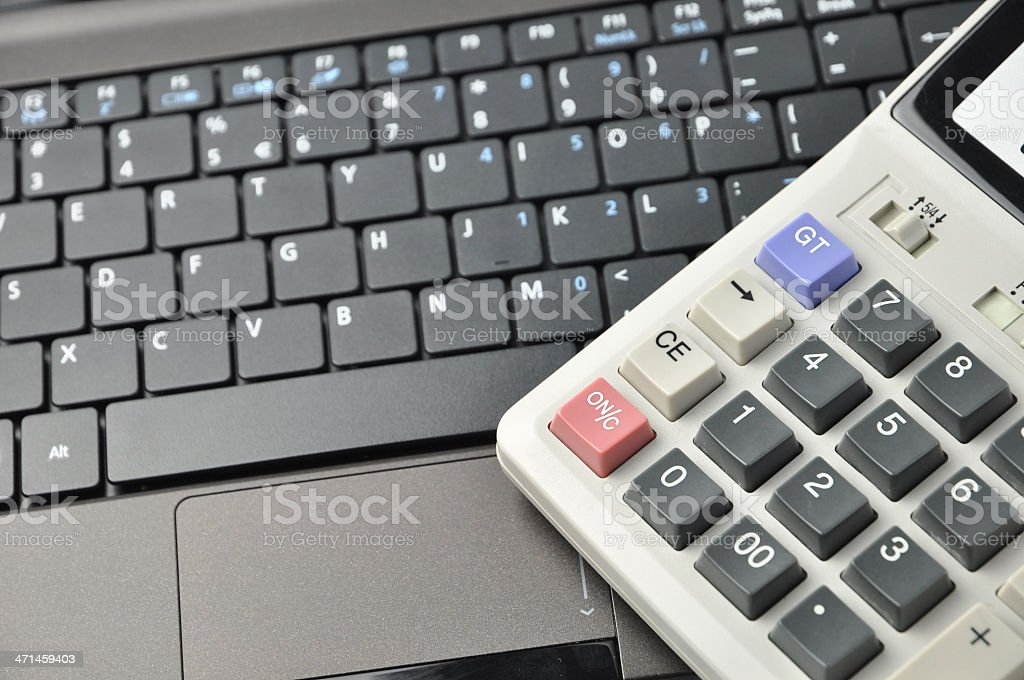 The caculator on laptop computer stock photo