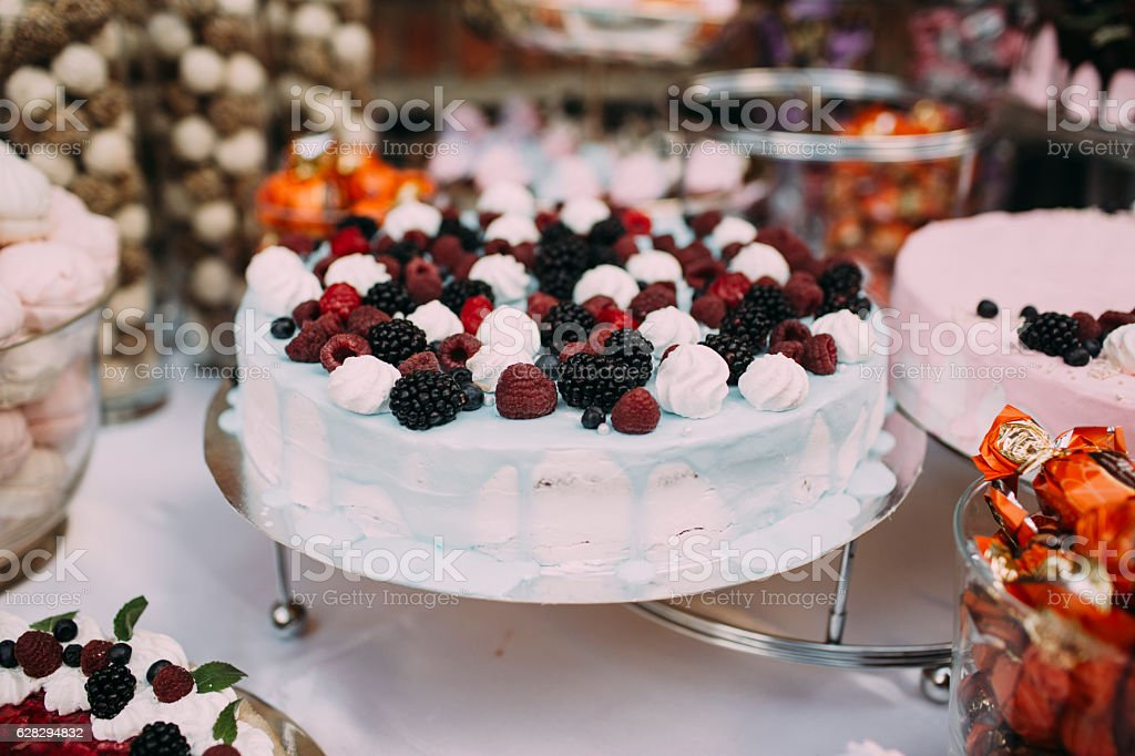 The cake with cream and berries stock photo