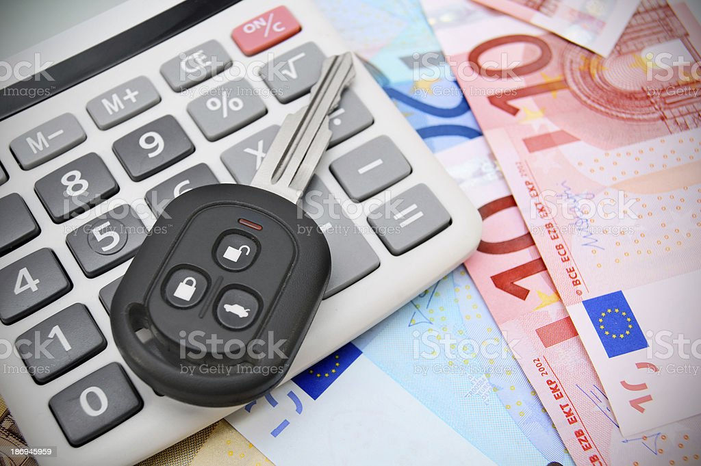 The calculator and key car royalty-free stock photo