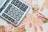 The calculator lies on big Russian money