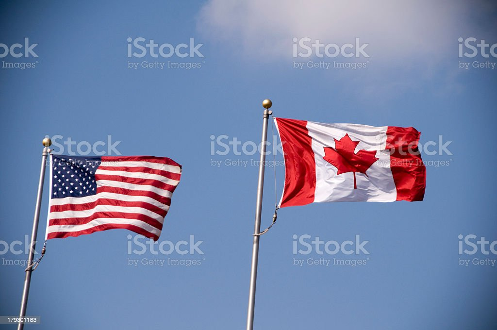 The Canadian flag and the American flag  royalty-free stock photo