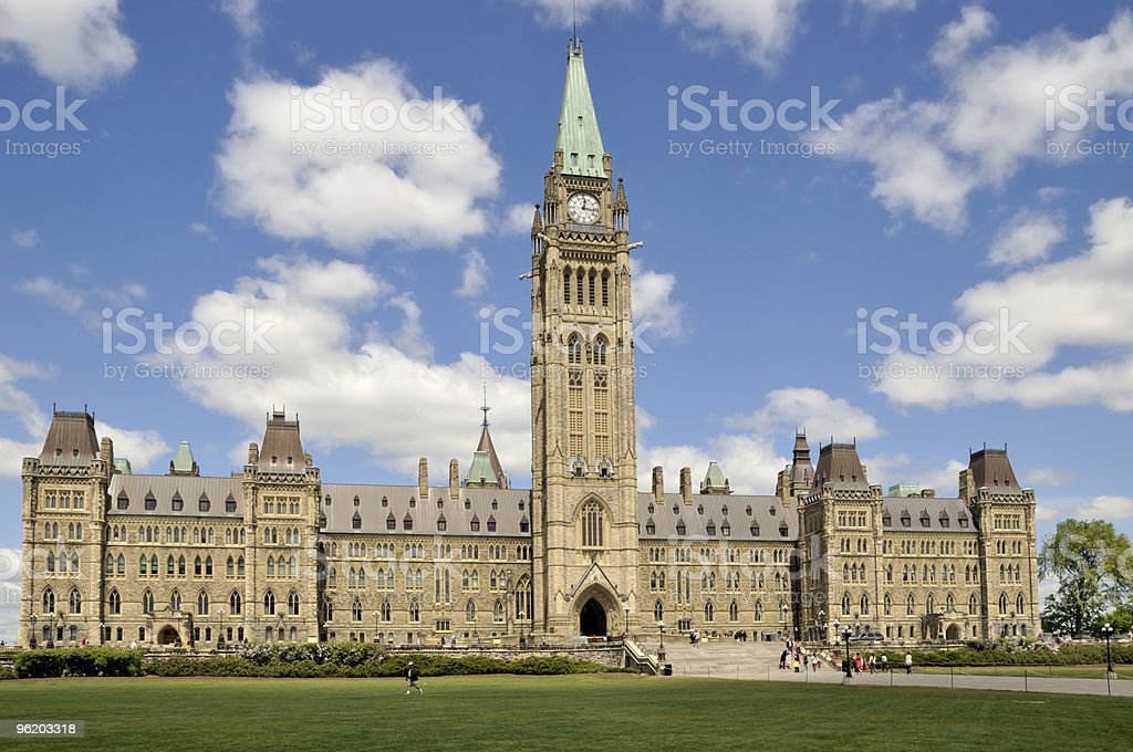 The Canadian Parliament on a blue sky with clouds royalty-free stock photo