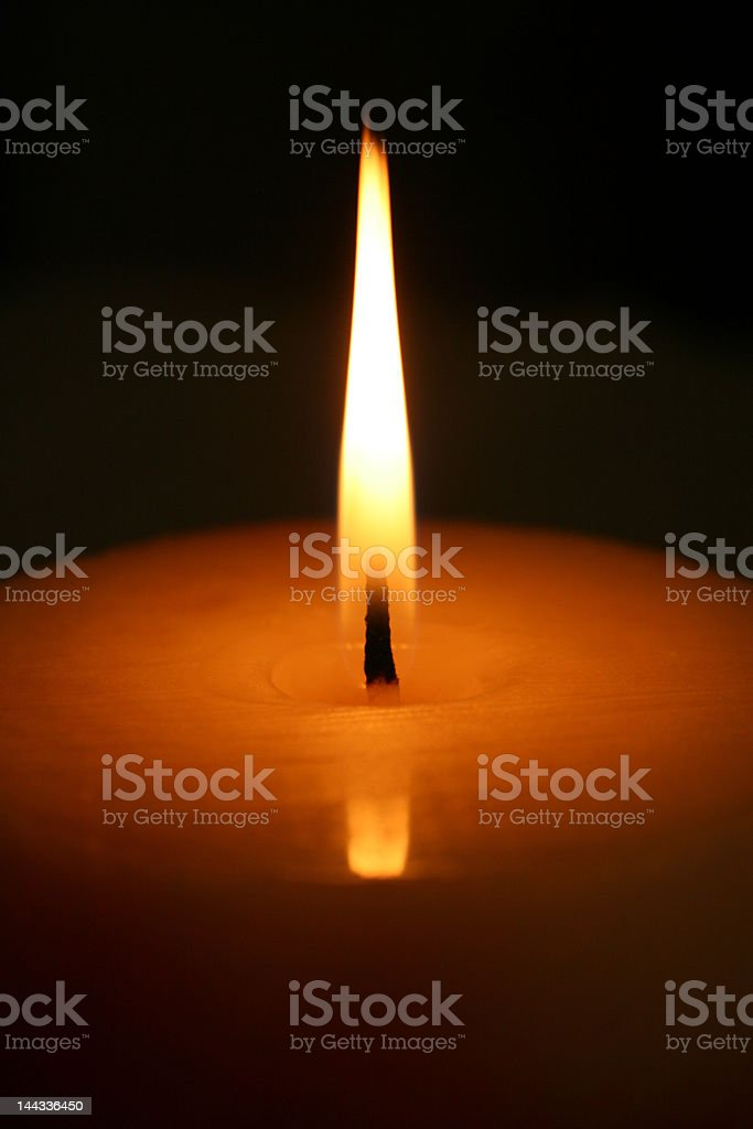 The candle's flame royalty-free stock photo