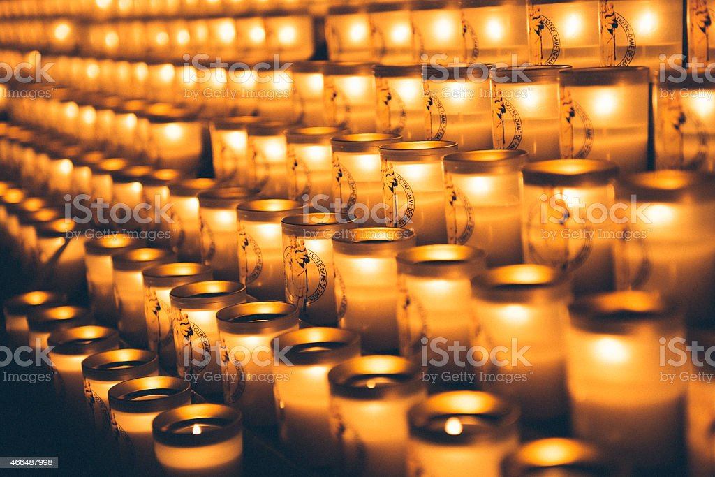 The candles of Notre Dame in Paris stock photo