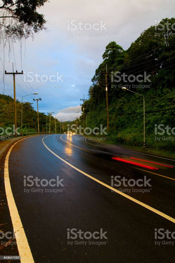 The car is moving quickly on the road. stock photo