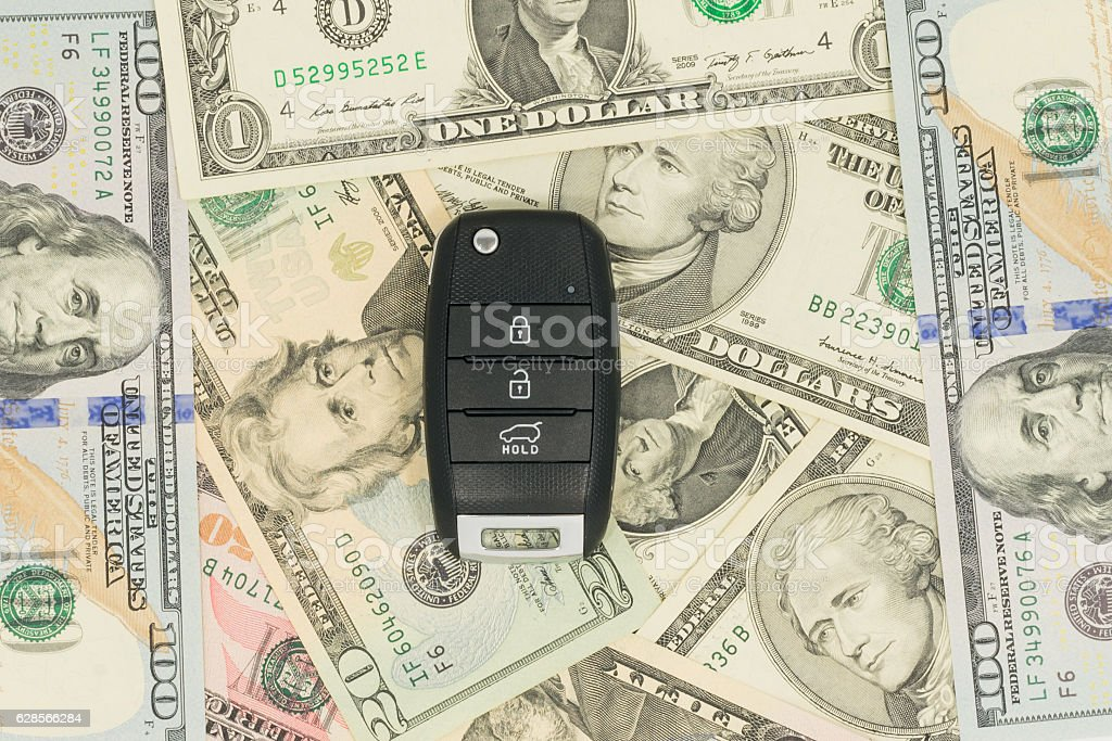 the car keys are on the money stock photo