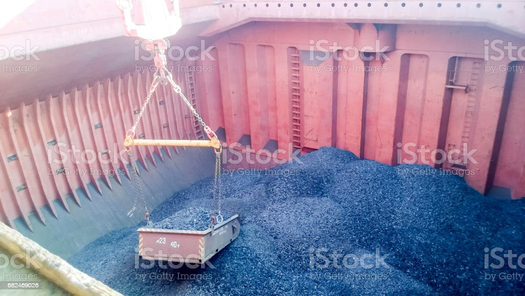 The cargo compartment of the ship, filled with coal. Loading of stock photo