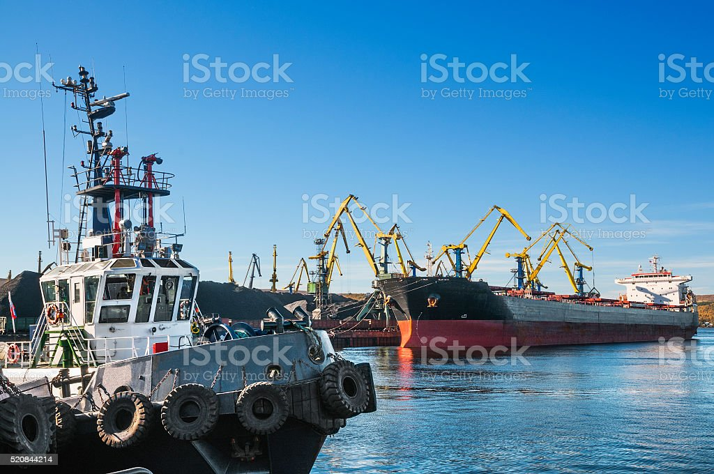 The cargo ship, tagboat  , harbor cranes, coal stock photo