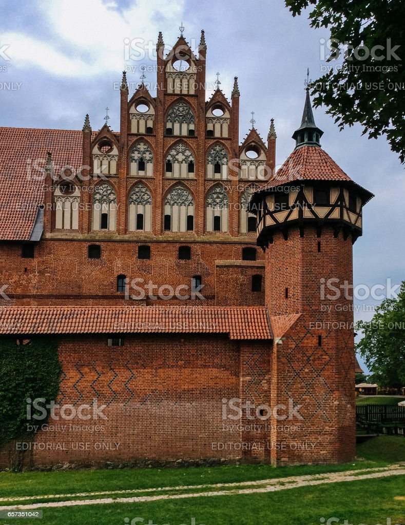 The Castle of the Teutonic Order in Malbork (German: Ordensburg Marienburg), located in the Polish town of Malbork, is the largest castle in the world measured by land area. stock photo