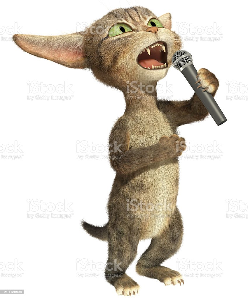The cat sings in a microphone stock photo