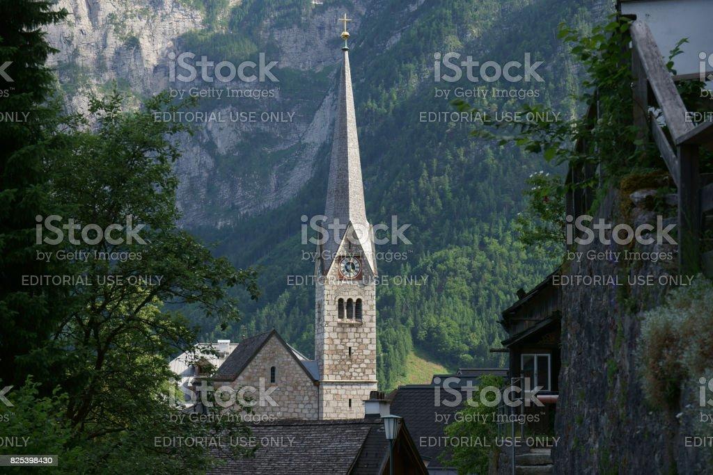 The Catholic Church of Hallstatt during the hot summer in Austria stock photo