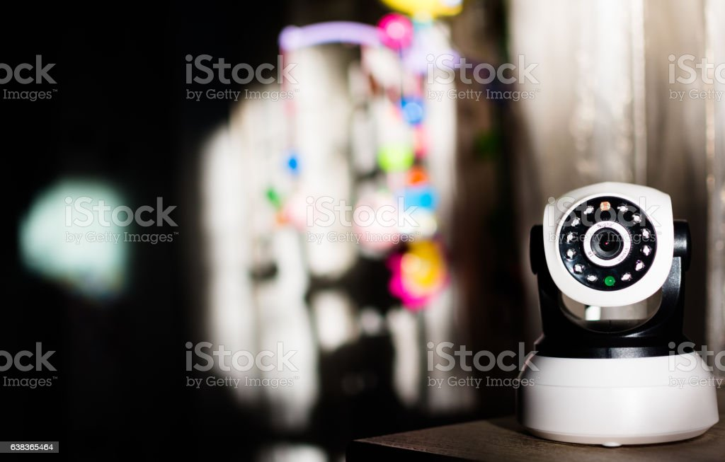 The CCTV security camera operating in home. stock photo