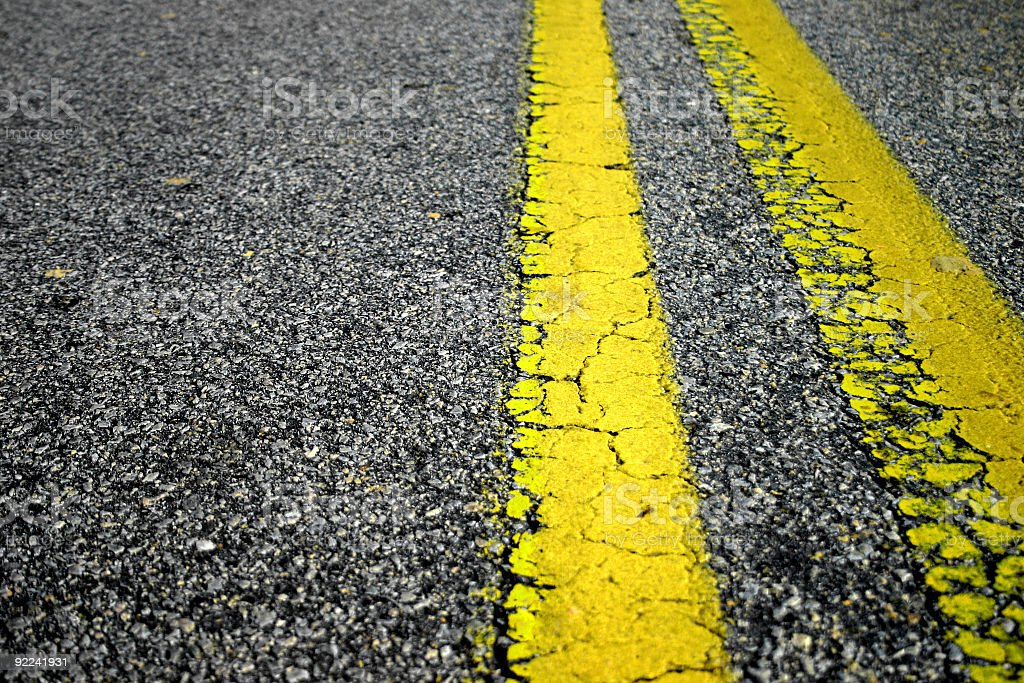The center yellow lines on a two lane road royalty-free stock photo