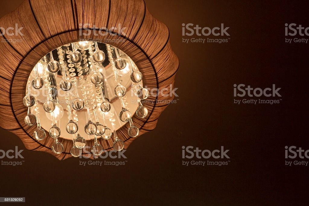 The chandelier is made of fabric with crystal pendants. stock photo