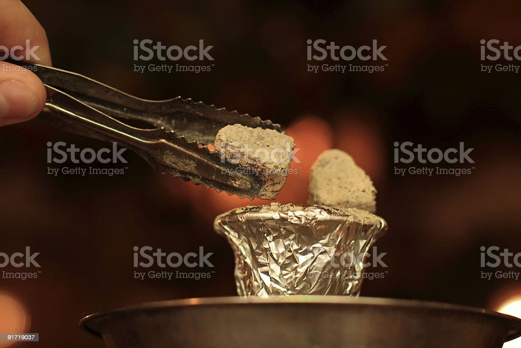 The charcoal for a hookah stock photo
