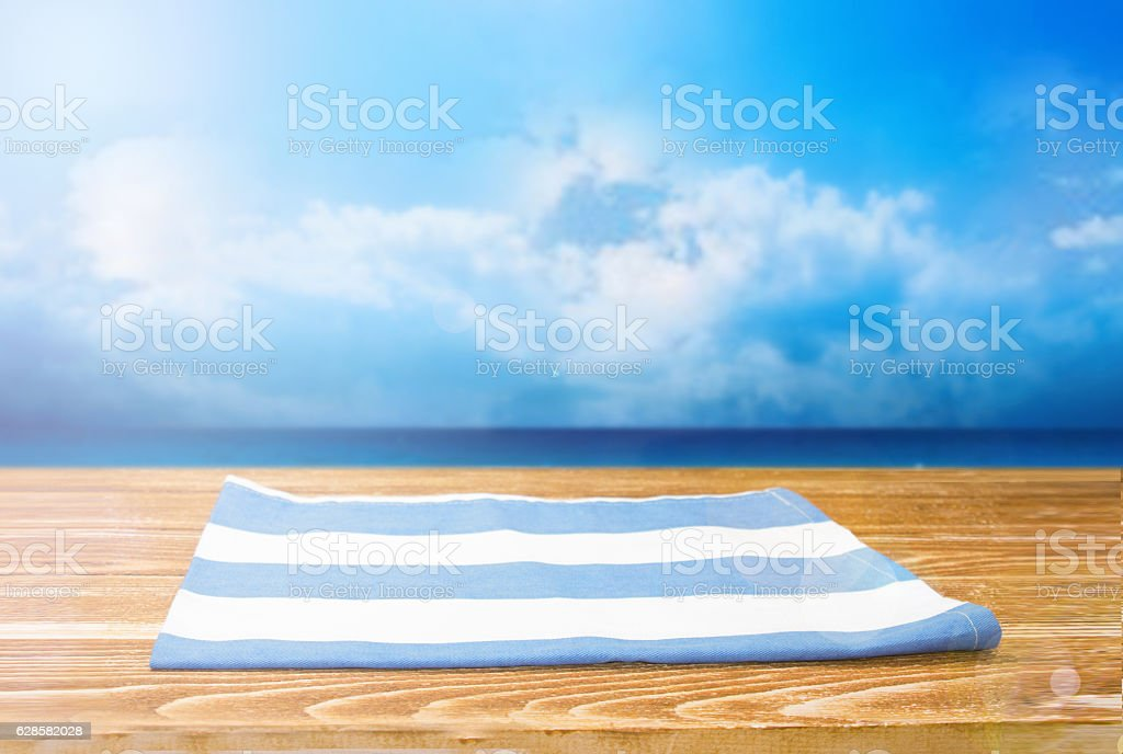 The checkered tablecloth on wooden table. stock photo