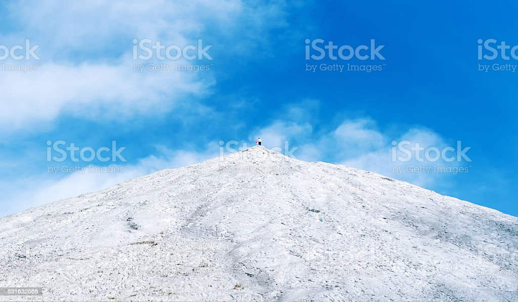 The chemical mountain against the blue sky. stock photo