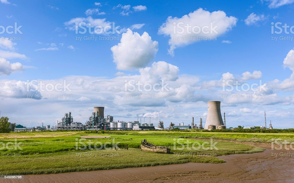 The chemical plant, the beck, and rotting boat, Paull, Yorkshire. stock photo