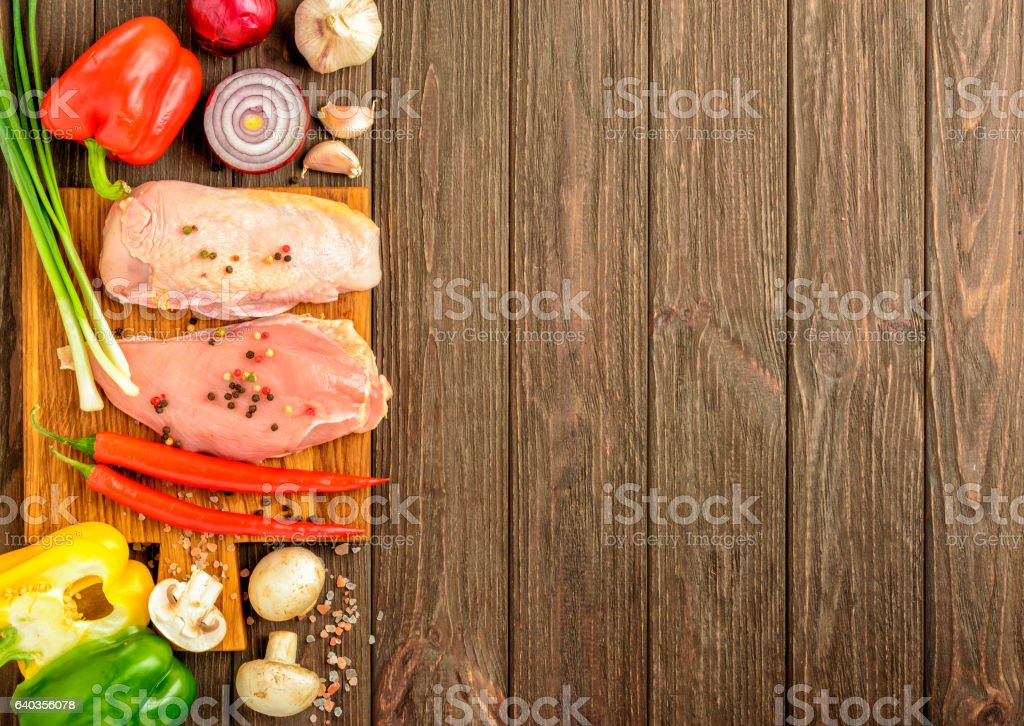 The chicken fillet and vegetables prepared for frying. Flat lay. stock photo