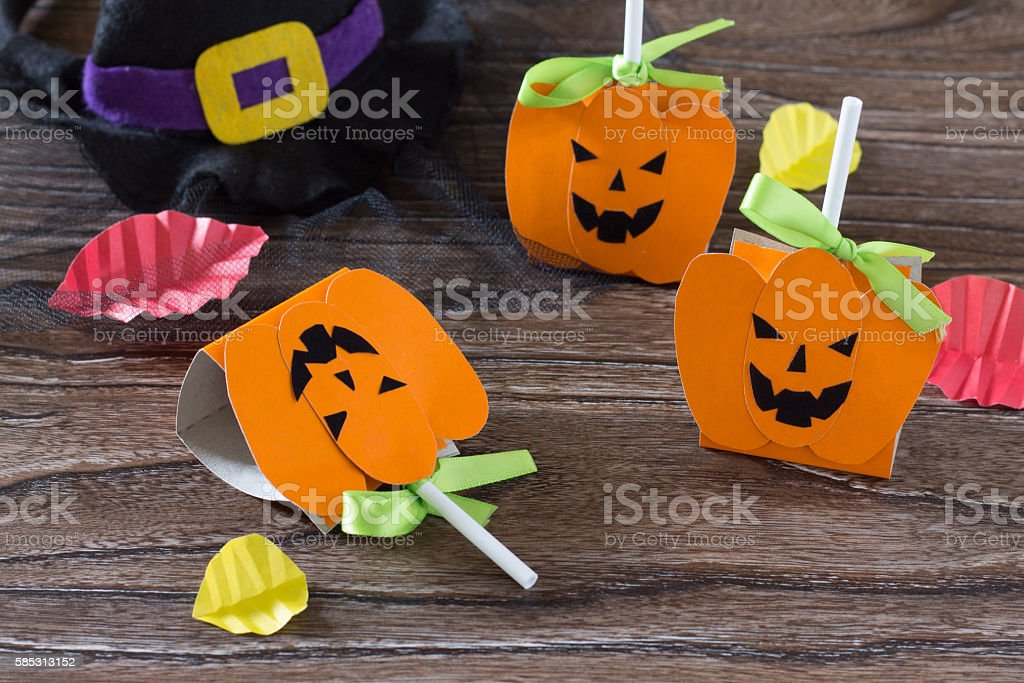 The child create a greeting packaging for lollipop on Halloween stock photo