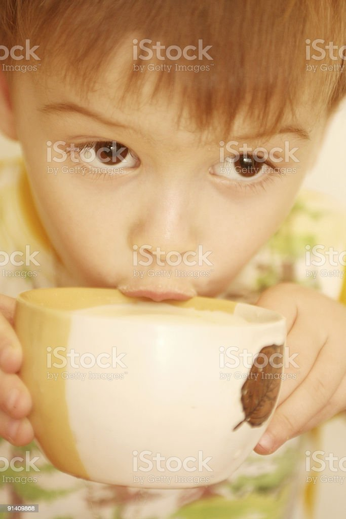 The child drinks milk royalty-free stock photo