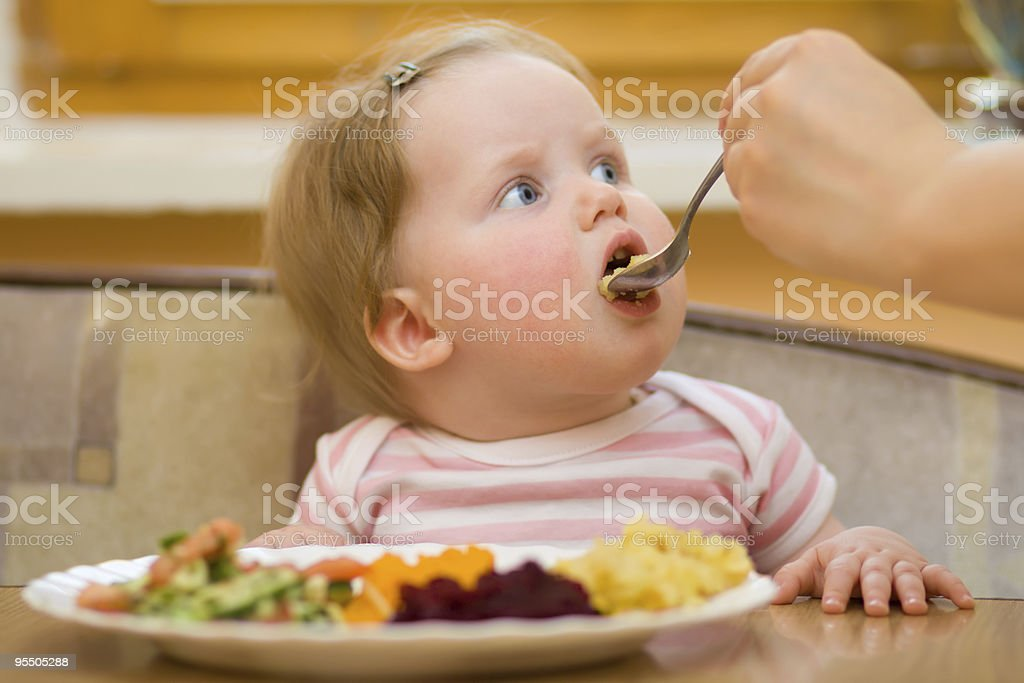 The child eats a vegetable salad royalty-free stock photo