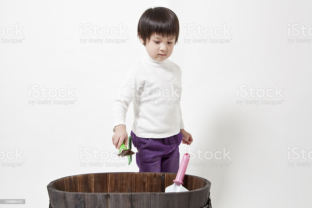 The child who makes gardening royalty-free stock photo