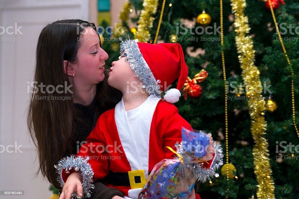 The child with his mother Christmas day stock photo