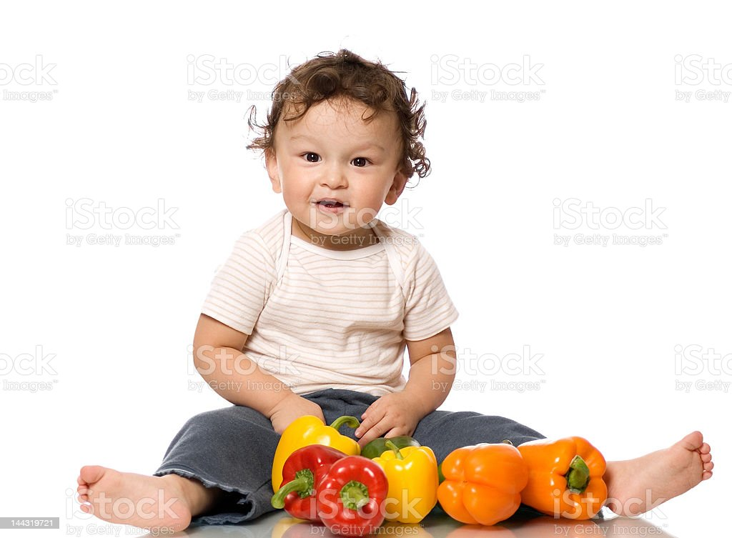 The child with paprika. royalty-free stock photo