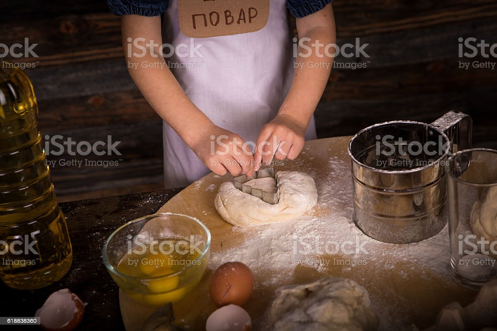 the children make biscuits from flour, sugar and eggs stock photo