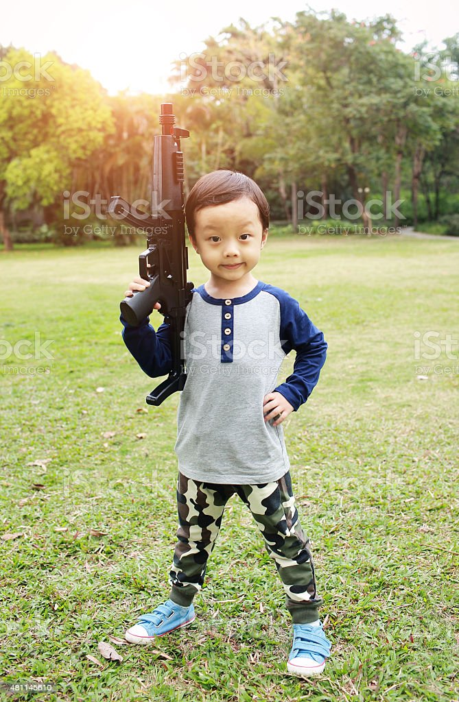 The children to play with toy guns stock photo