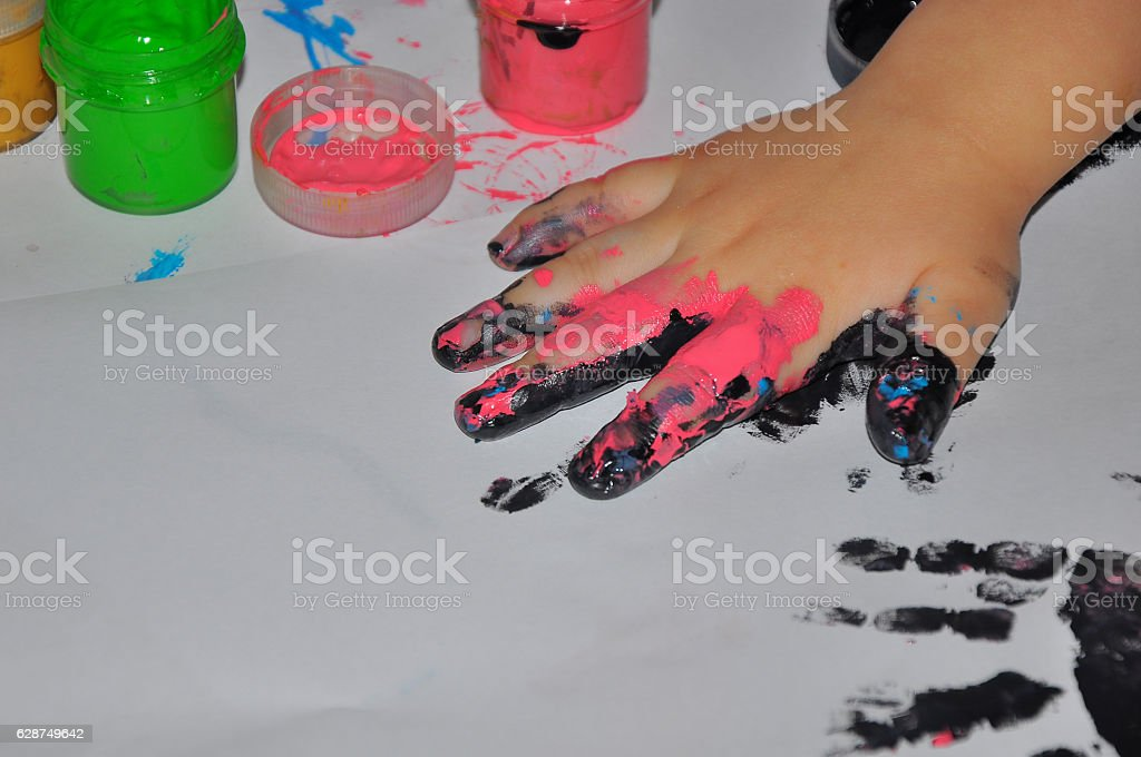 the children's hand soiled in paints stock photo