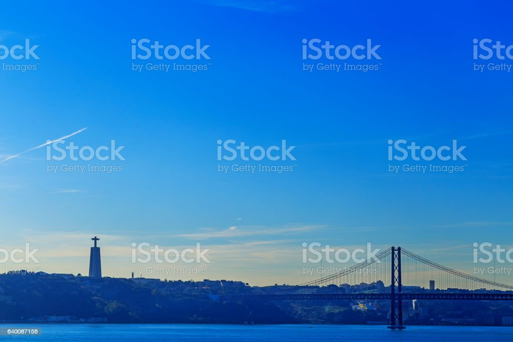 The Christ the King statue and 25 April bridge. stock photo