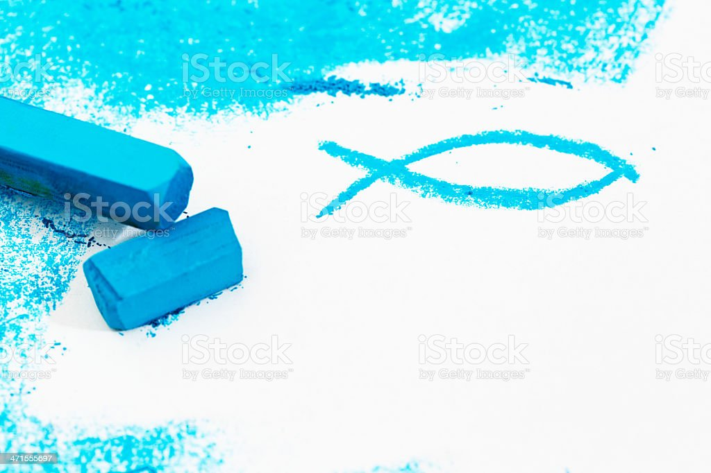 The Christian fish symbol sketched in turquoise pastel on white stock photo