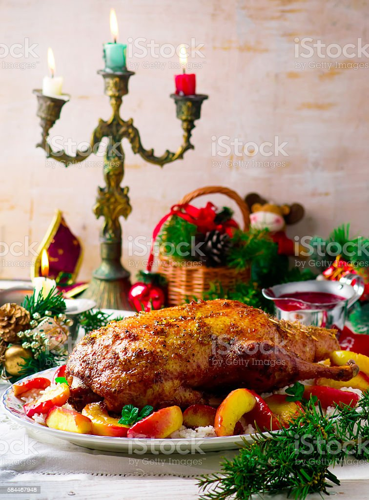 the Christmas baked duck with apples stock photo