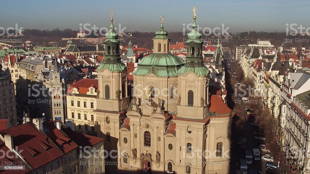 The Church of Saint Nicholas and tiled roofs old town stock photo