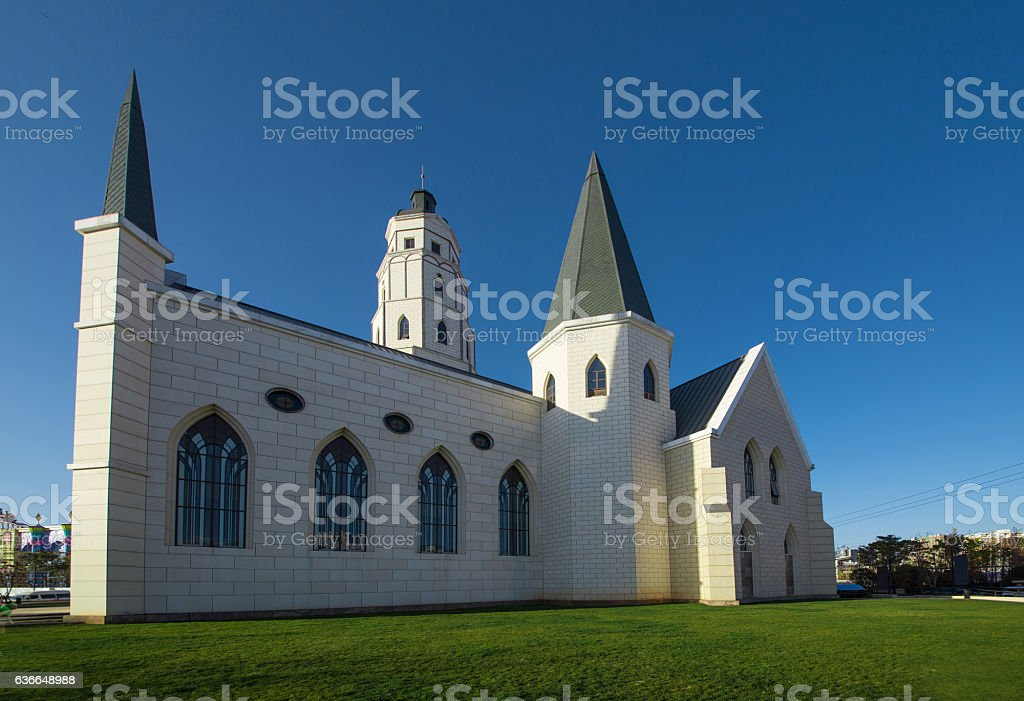 The church on the grass stock photo